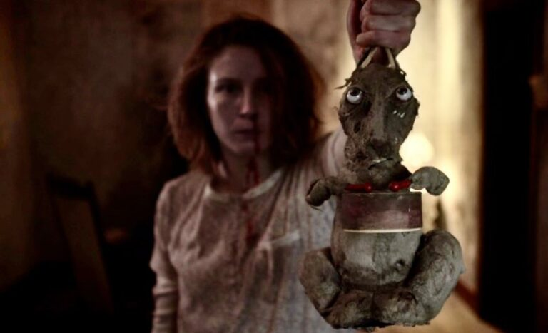 Caveat Review: David Lynch Meets Saw in Atmospheric Irish Horror Movie